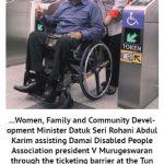 Women, Family and Community Development Minister Datuk Seri Rohani Abdul Karim assisting Damai Disabled People Association president V Murugeswaran through the ticketing barrier at the Tun Razak Exchange MRT station